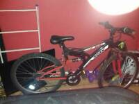 good present red and black sharmano 18 gears bike
