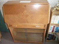 Light Oak Desk with fold down writing surface. Good condition