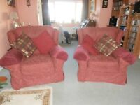 Large sofa & two large armchairs with original covers.
