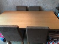 Dining Table and Four chairs for sale, bought from Argos .