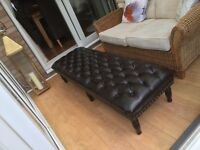 Large footstool brown leather look.