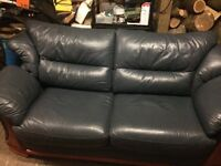 Bluey green in colour real leather sofa with wood trim