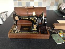 Singer manual sewing machine, attachments and instruction booklet