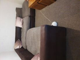 For sale a large corner sofa with large pouffe