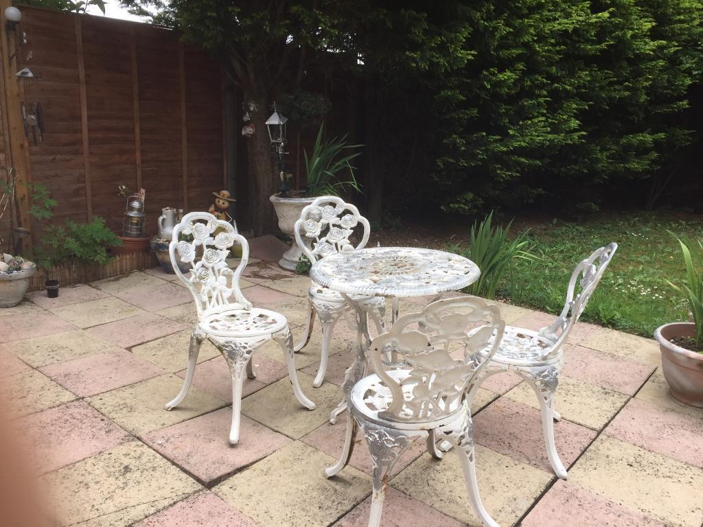 Cast iron garden victoria style table and chairs