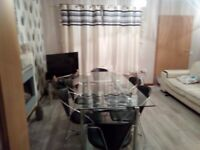 Glass dining table and six chairs. Good condition.