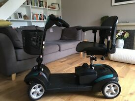 Electric Mobility, Rascal Veo, black/ teal mobility scooter with front basket.