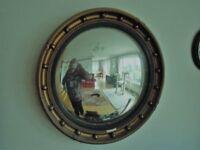 A Round Convex Giltwood Framed Mirror Circa 1920