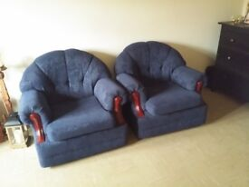 two medium-to-smaller size armchairs