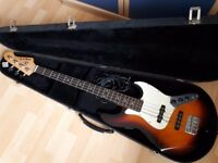 Aria STB series Bass Guitar with cable and hard case. Sunburst wood effect.