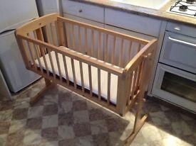 Mothercare wooden swinging crib.