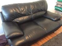 Harvey's two seater black leather sofas