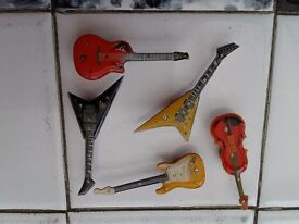 ENAMEL GUITARS X5. WITH STRONG MAGNET BACKING. £1.50 each or £5 THE LOT. NO TEXTS PLEASE.