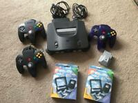 N64 console with 3 controllers, rumble pack, 9 games and 2 cleaning kits