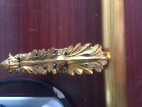 Gold ornate curtain rail