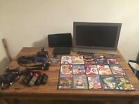 PS2 consol 16 games 2 controllers 2 sing star mics 4 buzz quiz controllers and FREE DVDs
