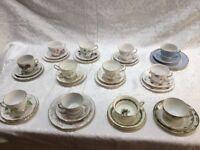 12 Assorted China Trio sets (Tea cups, saucers & side plates)