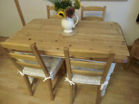 Sturdy solid pine Yorvik table and four pine chairs.