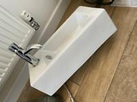 Wall hung basin with tap plug and brass waste