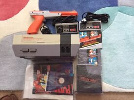 Classic Nintendo NES. Six rare games. Fully working order. Unable to validate gun order on new TVs.