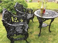 Amazing his & hers cast iron chairs and cast iron table .