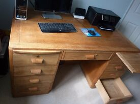 Solid wood desk 5ft long, 2.5ft high, 3ft depth, 8 drawers, 3 rear cupboards & 2 shelves