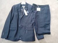 Boys age 11 years navy suit. Brand new with tags.