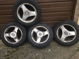 Alloy wheels and good tyres Toyota x 4 and extra tyre