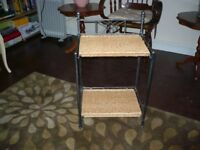 two bedside tables in wrought iron with woven tops. excellent cond hardly used