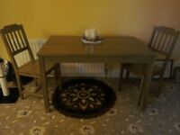 IKEA kitchen table and four chairs.good condition.