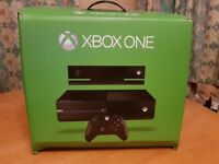 Xbox One Consul with Kinect and a controller.