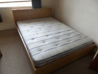 Contemporary double bed with mattress included