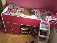 Mid sleeper pink bed, with draws book shelf behind ladder Mattress not included