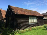 LARGE WOODEN CLAD GARDEN BUILDING SUITABLE FOR OFFICE, WORKSHOP, STORE OR GARAGE
