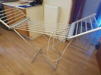 Electric hanging clothes airer, stores flat, used twice, get clothes dry quicker!:)