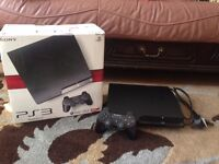 ps3 slim with power cables + 21 games and official controller