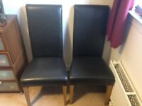 2 faux brown leather high back dining chairs