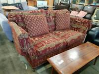 Egyptian style fabric two seater sofa and armchair suite