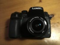 Panasonic GH4 DSLR Camera with Olympus Zuiko 12mm Prime lens