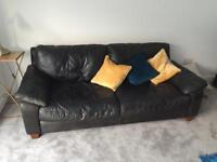 2 Black leather sofas