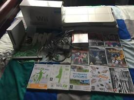 Wii Console, Wii Fit Board, 2 Controllers and 11 games
