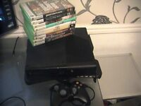 xbox 360E new model 320gb hard drive + games wired controller only 2 years old 25/9/2014