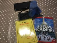 Guitar books and foot stool