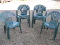 Eight off low back green plastic garden or function chairs