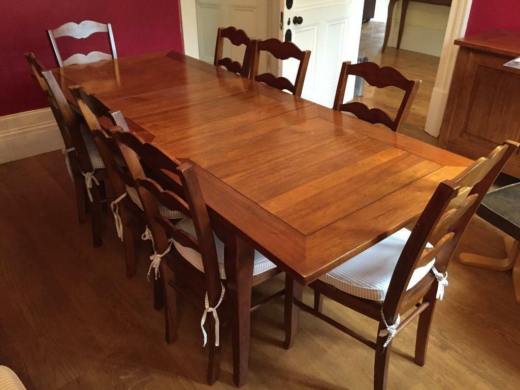 Wooden Dining Table And Eight Chairs