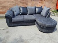 Fantastic Brand New black and grey fabric corner sofa with chase lounge.delivery available
