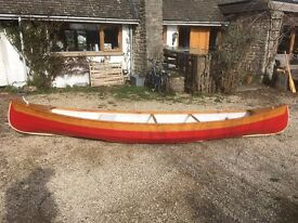 Wooden canoe, as new 16 foot, with paddles. Bargain!