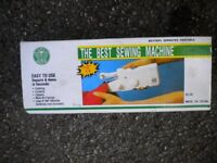 A UNUSED HAND HELD SEWING MACHINE STILL IN BOX