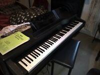 Yamaha Clavinova electric piano and matching footstool