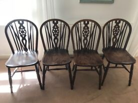 4 wooden antique wheel back dining chairs £40